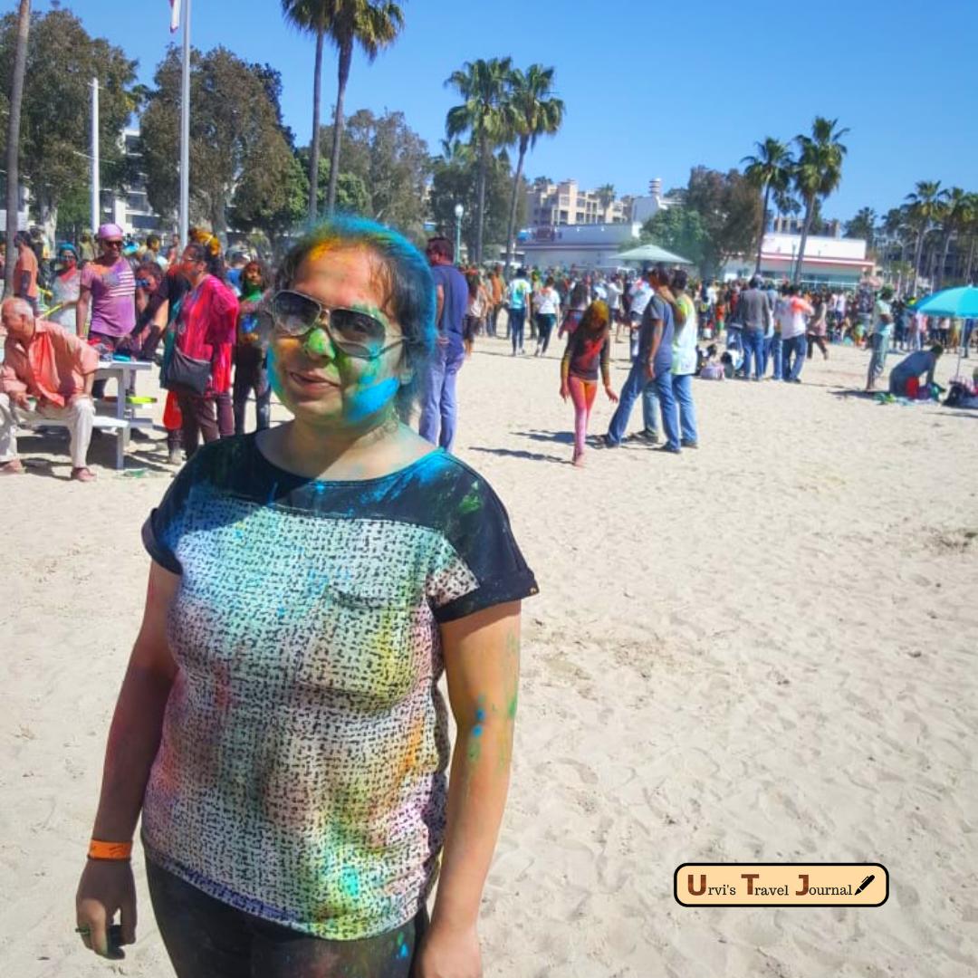 celebration of holi on the beach